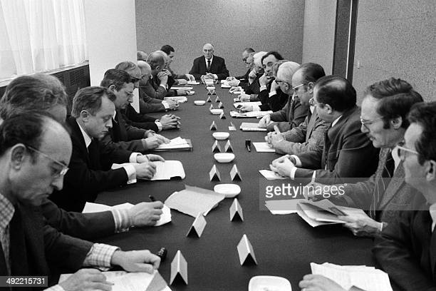 Picture taken on January 09, 1975 in Paris at the French press agency Agence France Presse shows an editorial meeting chaired by Jean Marin ,...