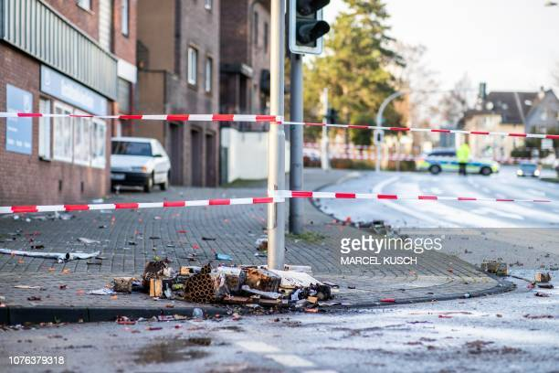 A picture taken on January 1 2019 in Bottrop shows a cordoned off area at the site where a man injured four people after driving into a group...