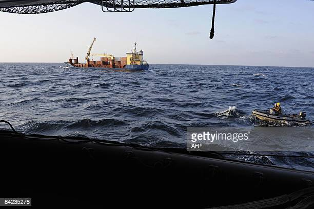 A picture taken on January 10 2009 aboard the French Frigate le Floreal sailing in the Gulf of Aden shows a danish commercial ship the Puma Svendborg...