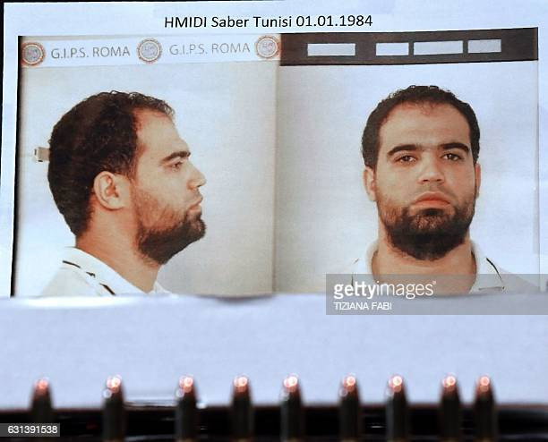 A picture taken on January 10 2017 shows a mug shot of Hmidi Saber a suspected member of Ansar alSharia a Libyan group linked to alQaeda displayed by...