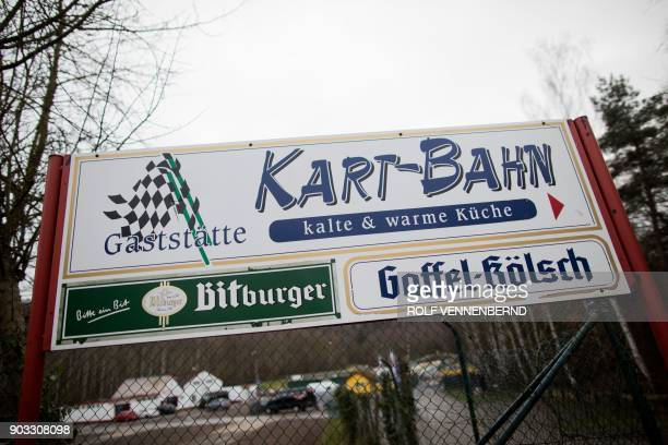 A picture taken on January 10 2018 shows boards at the entrance of the karting circuit in Kerpen located 30 kilometres from Cologne in western...
