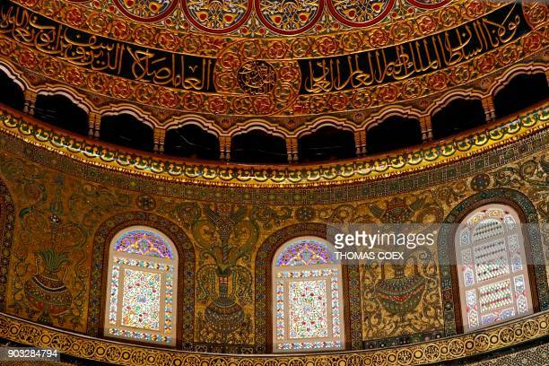 A picture taken on January 10 shows mosaic decoration and Arabic caligraphy inside the Dome of the Rock mosque at the AlAqsa mosque compound in...