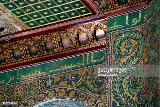 A picture taken on January 10 shows mosaic decoration and Arabic caligraphy which reads Jesus Christ inside the Dome of the Rock mosque at the AlAqsa...