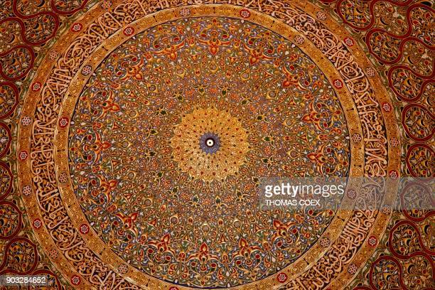 A picture taken on January 10 shows the decorated interior of the golden dome inside the Dome of the Rock mosque at the AlAqsa mosque compound in...