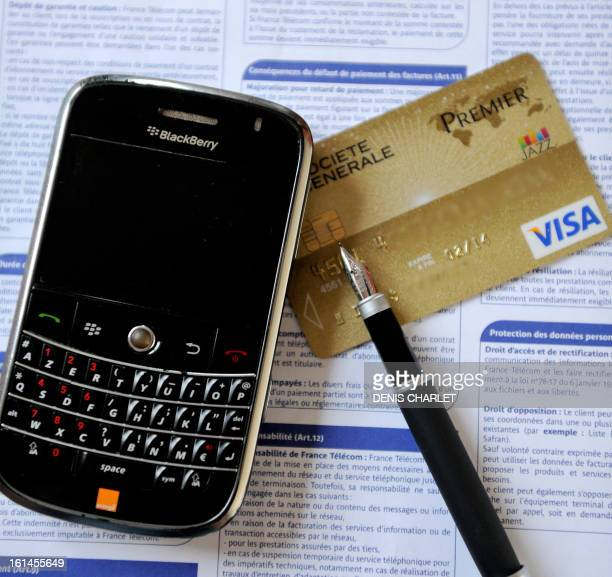 A picture taken on January 11 2013 in Lille northern France shows a BlackBerry cell phone next to a Visa Premier credit card AFP PHOTO / DENIS CHARLET
