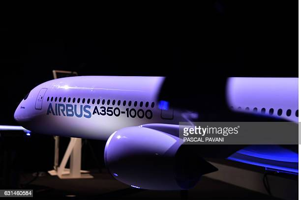 A picture taken on January 11 2017 shows a miniature of an airbus A350 displayed at the Airbus headquarters in Blagnac / AFP / afp / PASCAL PAVANI