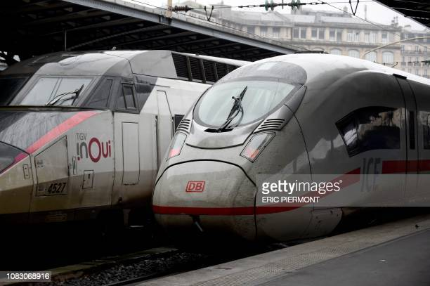 A picture taken on January 11 2019 at the Gare de l'Est railway station in Paris shows a French SNCF's INOUI high speed TGV train near a Deutsche...