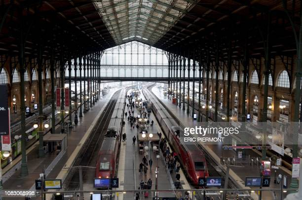 Picture taken on January 11, 2019 at the Gare du Nord railway station in Paris shows trains at a standstill .