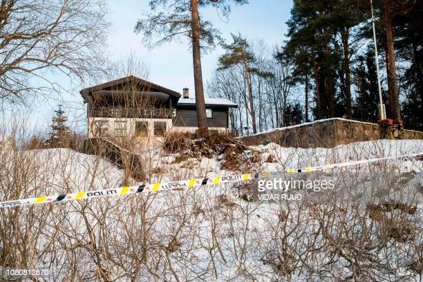 A picture taken on January 11 2019 shows a police cordon outside the home of Norwegian billionaire Tom Hagen and his wife AnneElisabeth Falkevik...