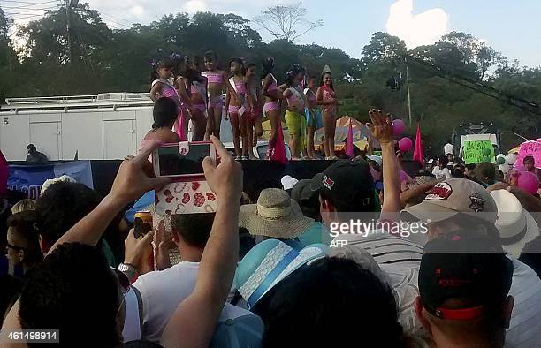 Picture taken on January 11 of young girls competing on a contest wearing bikinis as part of the annual Festival del Rio Suarez on Barbosa, in...