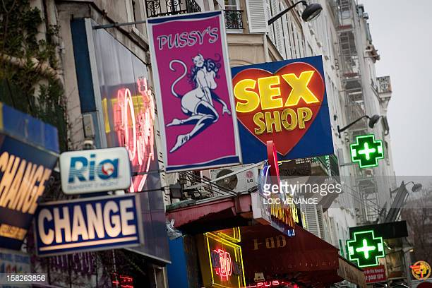 A picture taken on January 12 2011 shows sex shops at the Paris district of Pigalle AFP PHOTO LOIC VENANCE