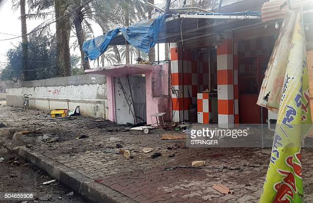 A picture taken on January 12 2016 shows a general view of the site where a bomb exploded at a cafe and a suicide bomber detonated an...
