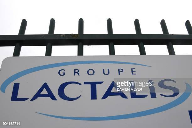A picture taken on January 12 2018 shows the logo at the entrance of the headquarters builing of French dairy group Lactalis in Laval western France...