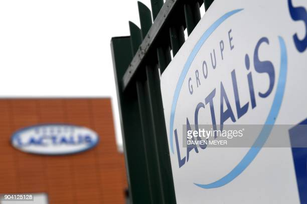 A picture taken on January 12 2018 shows the logo of French dairy group Lactalis on a building in Laval western France France said on January 11...