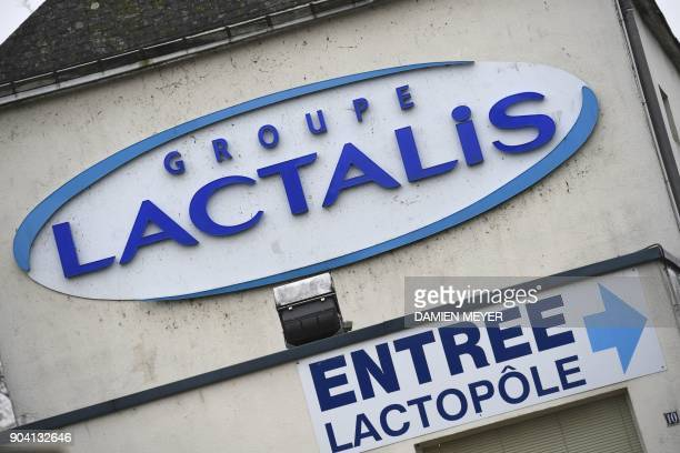 A picture taken on January 12 2018 shows the logo on the headquarters builing of French dairy group Lactalis in Laval western France France said on...