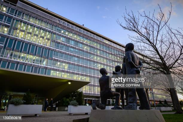 A picture taken on January 12 2020 shows statues in front of the World Health Organization headquarters prior to a combined news conference following...