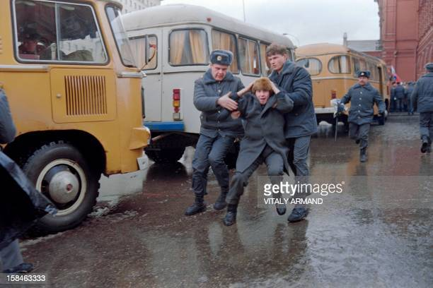 A picture taken on January 13 1991 in Moscow shows Soviet militiamen arresting a man during a demonstration against the Soviet army crackdown in...