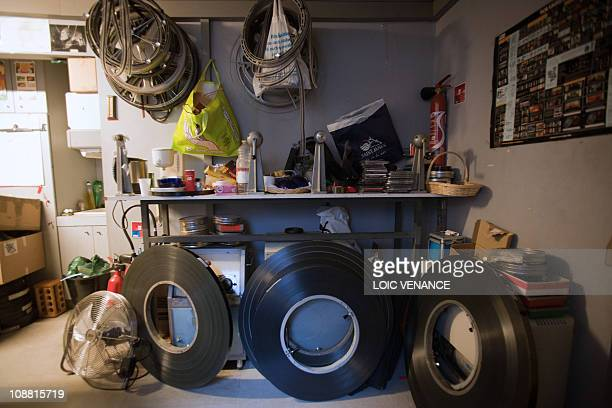 A picture taken on January 13 2011 in Paris shows film rolls at the projection room of the Studio des Ursulines movie Theatre AFP PHOTO LOIC VENANCE