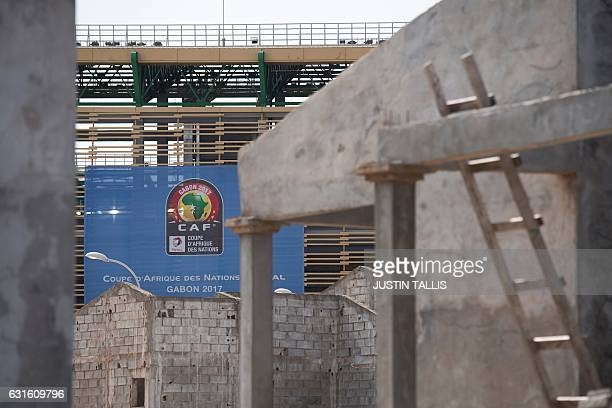 A picture taken on January 13 2017 shows under construction buildings by the PortGentil's stadium in PortGentil ahead of the 2017 Africa Cup of...