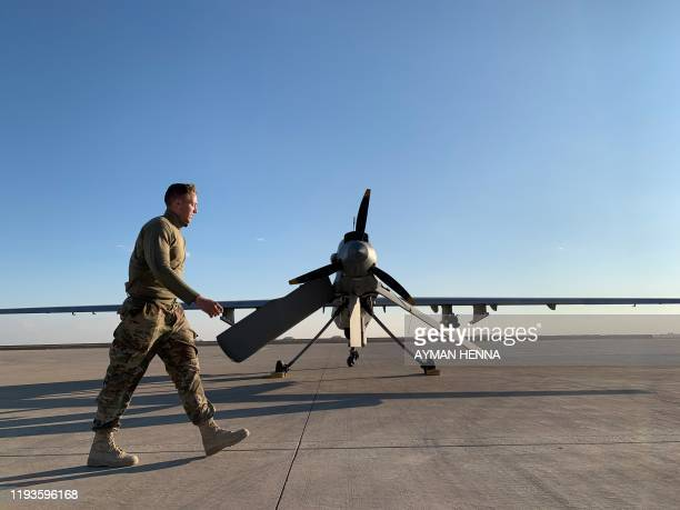 A picture taken on January 13 during a press tour organised by the USled coalition fighting the remnants of the Islamic State group shows a member...