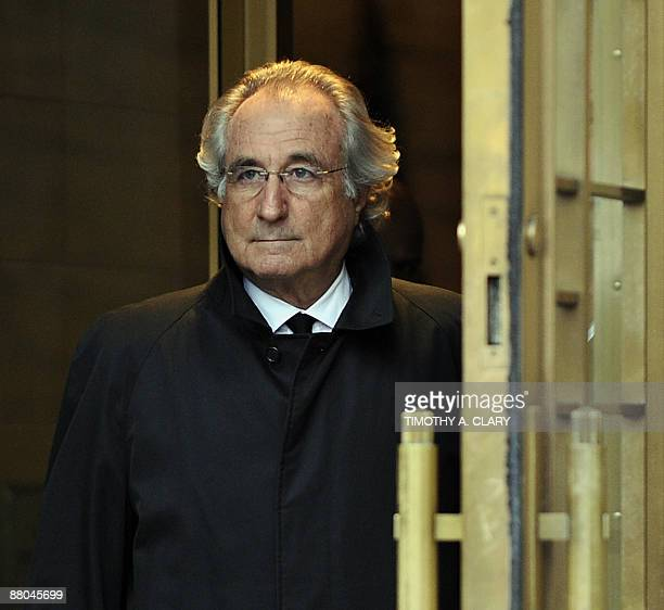A picture taken on January 14 2009 in New York shows Bernard Madoff leaving US Federal Court after a hearing regarding his bail The French...