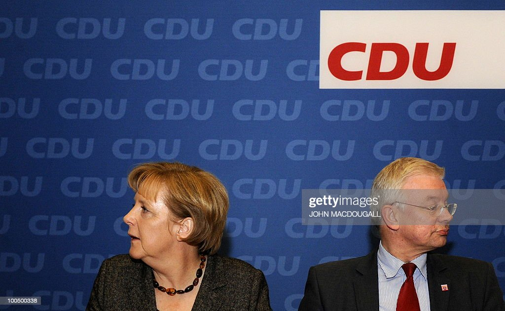 FILES - Picture taken on January 14, 2010 shows German Chancellor Angela Merkel and Hesse Premier Roland Koch waiting for the start of a Christian Democratic Union (CDU) meeting of the party leadership in Berlin, to flesh out their strategy for the year to come. Koch, a powerful rival of German Chancellor Angela Merkel and a big-hitting regional baron in her party announced his surprise resignation on May 25, 2010, but denied it was due to any spat.