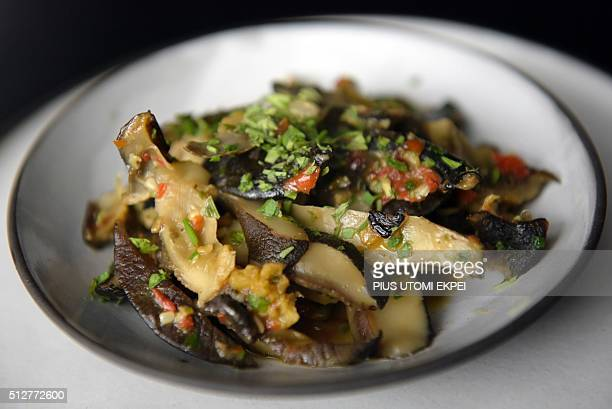 A picture taken on January 14 2016 shows snail food prepared by Pierre Thiam at Nok By Alara a restaurant in Victoria Island district of Lagos An...
