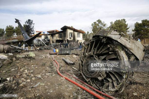 A picture taken on January 14 2019 shows a Boeing 707 cargo plane that reportedly crashed into a residential complex near the Iranian capital Tehran...