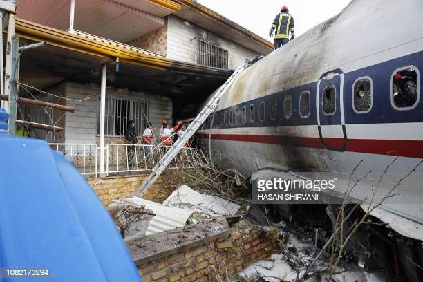 TOPSHOT A picture taken on January 14 2019 shows a Boeing 707 cargo plane that reportedly crashed into a residential complex near the Iranian capital...