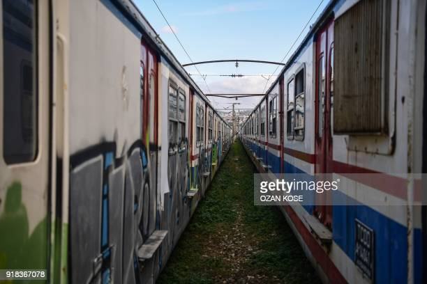 A picture taken on January 15 2018 shows scrap trains decorated with graffitis at the Haydarpasa train station in Istanbul Built in the first decade...
