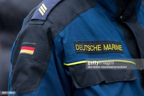 A picture taken on January 15 2018 shows the jacket of a soldier of the German navy bearing the inscription Deutsche Marine on board the defense...