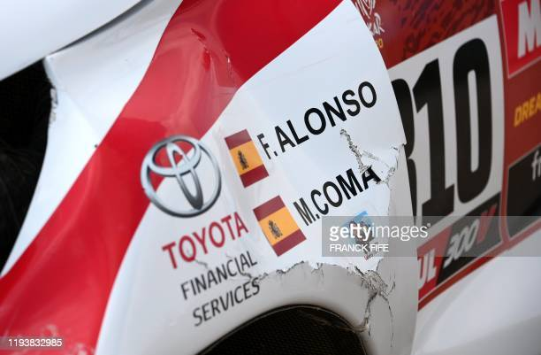 Picture taken on January 15, 2020 shows a detail of the damaged car of Toyota's Spanish driver Fernando Alonso and Spanish co-driver Marc Coma after...