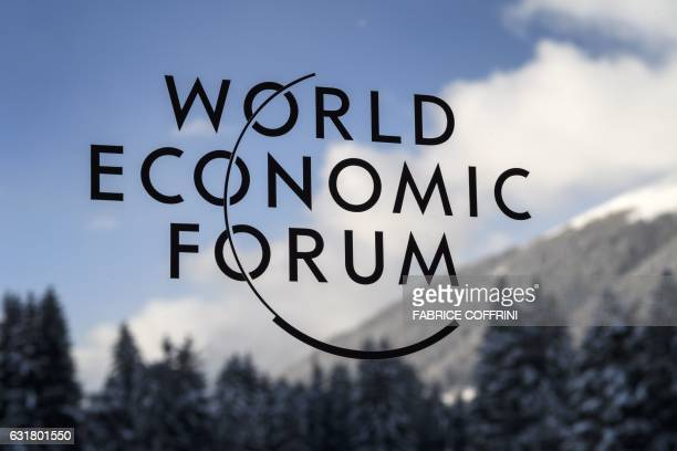 A picture taken on January 16 2017 shows a sign of the World Economic Forum at Davos' Congress Center on the eve of the opening day of the summit...