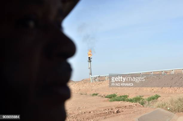 A picture taken on January 16 2018 at In Amenas gas plant300 kilometres southeast of Algiers shows a worker at the site during a ceremony to mark...