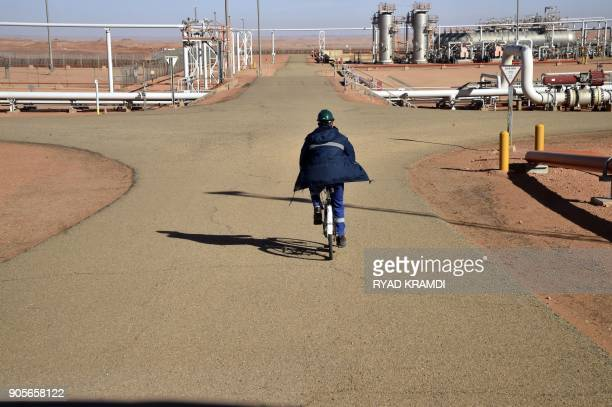 A picture taken on January 16 2018 at In Amenas gas plant300 kilometres southeast of Algiers shows a worker riding a bike at the site following a...