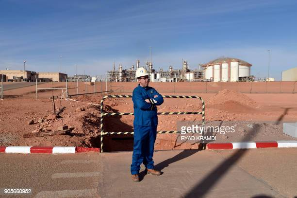 A picture taken on January 16 2018 at In Amenas gas plant300 kilometres southeast of Algiers shows a worker at the site following a ceremony to mark...