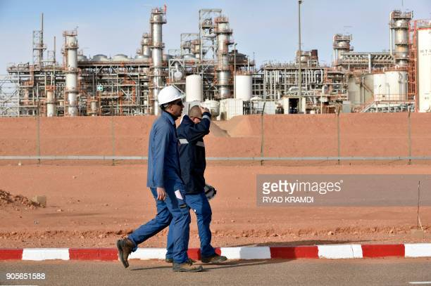 A picture taken on January 16 2018 at In Amenas gas plant300 kilometres southeast of Algiers shows workers walking at the site ahead of a ceremony to...