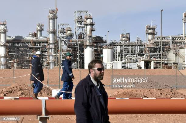 A picture taken on January 16 2018 at In Amenas gas plant300 kilometres southeast of Algiers shows workers at the site during a ceremony to mark five...