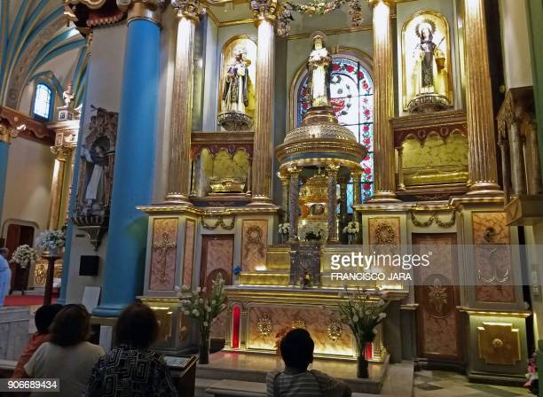 Picture taken on January 16 2018 of faithful visiting the altar of the Basilica and Convent of Santo Domingo in Lima where the relics of Peruvian...
