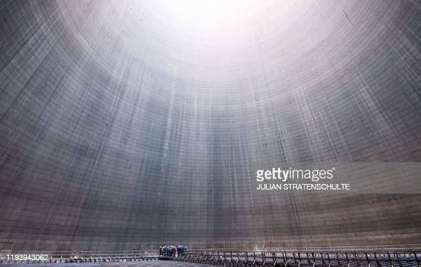 Picture taken on January 16, 2020 shows a group visiting the inside of a cooling tower at Mehrum coal-fired power plant in Hohenhameln, Germany. /...