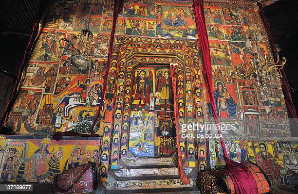 A picture taken on January 17 2012 shows detailed paintings depicting events of religious significance for Ethiopian Orthodox Christians at Ure...