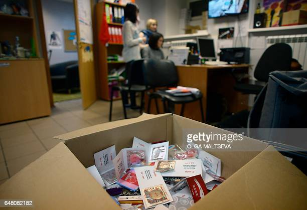 Picture taken on January 17, 2017 shows condoms in the box at the office of Russia's only NGO for sex workers called Serebryanaya Roza, or Silver...