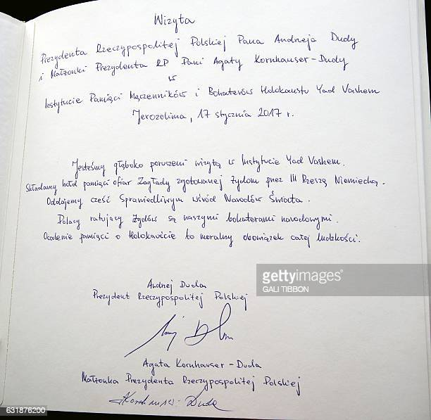 A picture taken on January 17 2017 shows the dedication written by Polish President Andrzej Duda in the guestbook at the Hall of Names during his...