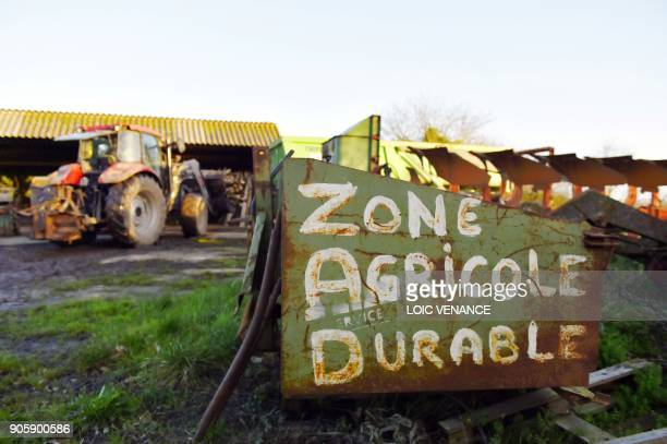 A picture taken on January 17 2018 shows an inscription reading 'sustainable agricultural area' in La Vache rit a farm in the 'Zad' of...