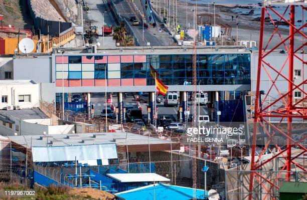 Picture taken on January 17 shows the border crossing between Morocco and the Spanish territory of Ceuta. - After years of back-breaking toil, Fatima...