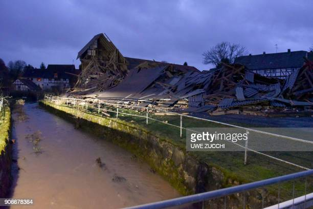 A picture taken on January 18 2018 shows rubble after a barn collapsed at a farm due to strong winds in Meimbressen central Germany Violent gales...