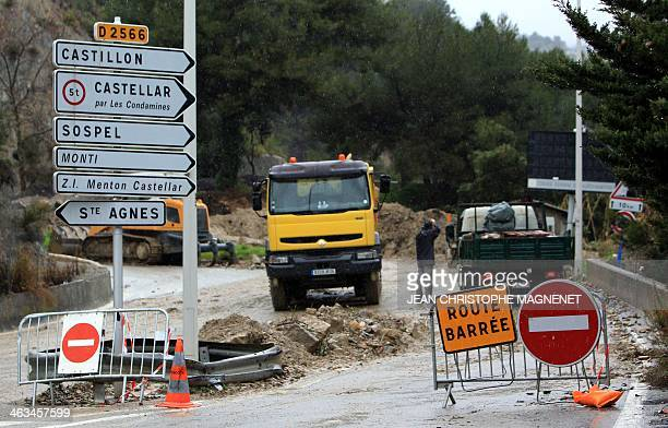 A picture taken on January 18 shows a closed road blocked by a landslide in Menton southeastern France Many roads have been closed in the French...