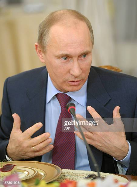 A picture taken on January 18 shows Russia's Prime Minister Vladimir Putin gesturing during a meeting with the editors of leading Russian newspapers...