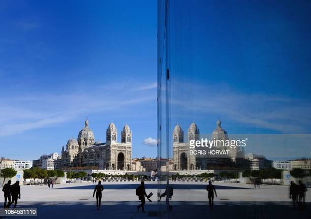 TOPSHOT A picture taken on January 182019 shows the Major Cathedral reflected in the windows of the Museum of European and Mediterranean...