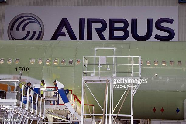 A picture taken on January 19 2012 shows employees working on the assembly line of Airbus A330 at the Airbus plant in Colomiers southwestern France...